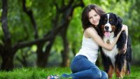 Cute girl and dog at garden wallpaper