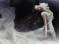 Wind blowing up dress wallpaper